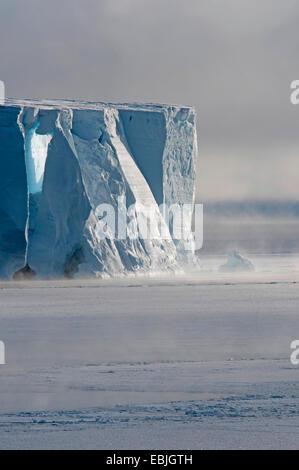mist around the edge of a table iceberg near the iceberg resting place Austasen, Antarctica - Stock Photo
