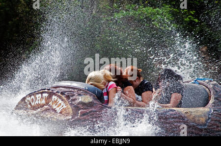 four young women in white-water ride, Germany, North Rhine-Westphalia, Sauerland, Bestwig - Stock Photo