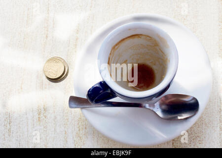 Empty espresso cup on cafe table - Stock Photo