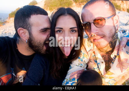 Close up of three young adult friends making faces at coast, Marseille, France - Stock Photo