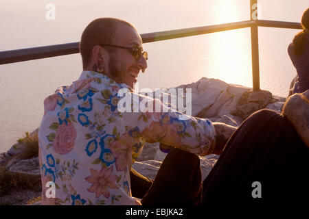 Two young men sitting chatting at coast, Marseille, France - Stock Photo