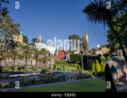 A general view of the central piazza at Portmeirion village surrounded by colourful Italian styled buildings and - Stock Photo