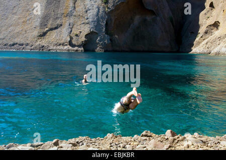 Two young men diving into sea and swimming, Marseille, France - Stock Photo