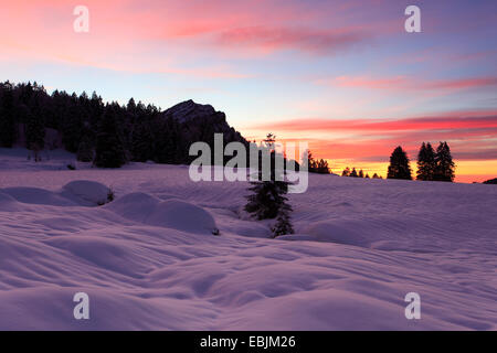 red sky over snow-covered plain in the Appenzell Alps, Switzerland, Appenzell - Stock Photo