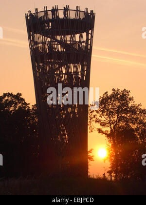 wooden tower in front of sunset, Juebergturm, Germany, Hemer - Stock Photo