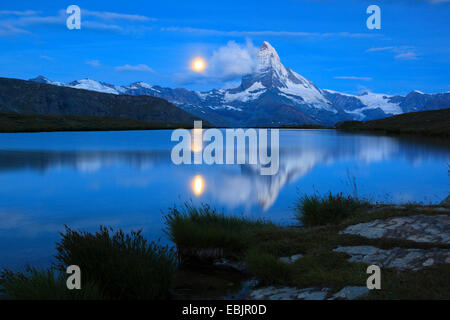 Matterhorn and lake Stellisee at full moon, Switzerland, Valais - Stock Photo