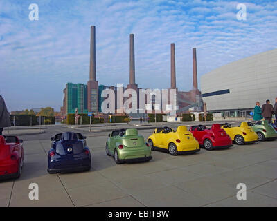 row of toy cars on a parking lot in front of the VW factory, Germany, Lower Saxony, Wolfsburg - Stock Photo