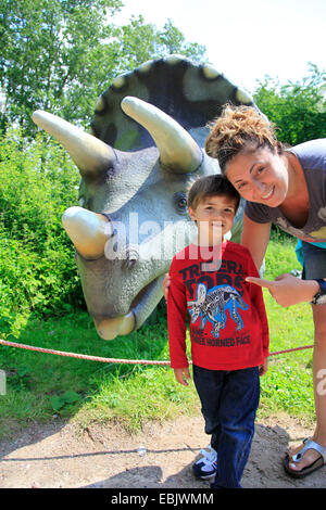 Three Horned Dinosaur (Triceratops), mother with child in front of a Triceratops - Stock Photo