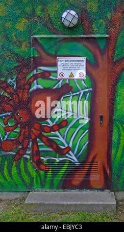 spider in its web painted on a wall of a kindergarden, Germany - Stock Photo