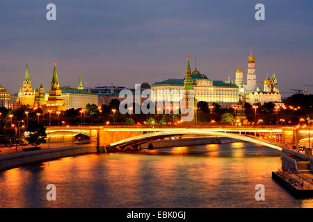 View of Kremlin towers and the Bolshoy Kamenny bridge over Moskva river at night, Moscow, Russia - Stock Photo