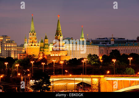 View of Kremlin towers and the Bolshoy Kamenny bridge at night, Moscow, Russia - Stock Photo