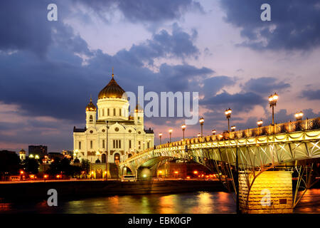 View of Cathedral of Christ the Saviour and Patriarshy Bridge over Moskva river at night, Moscow, Russia - Stock Photo