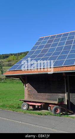 solar panels on the roof of a farm building, Germany - Stock Photo