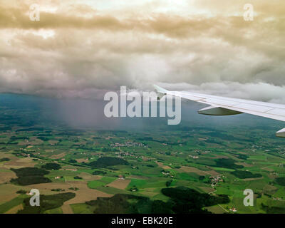 aerial view to rain clouds and rain shower, Germany, Bavaria, Flughafen Muenchen - Stock Photo