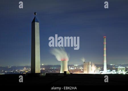 view from obelisk on stockpile Halde Hoheward to STEAG power station at night, Germany, North Rhine-Westphalia, - Stock Photo