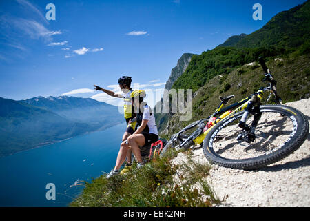 mountainbiker in the mountains having a break, Italy - Stock Photo