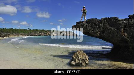 woman standing on rock spur in the bay of Diego Suarez, Madagascar, Diego Suarez - Stock Photo