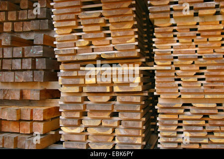 wooden boards stucked in a saw mill, Germany, Lower Saxony - Stock Photo