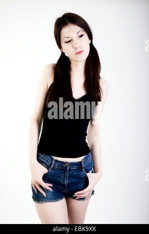 Young woman wearing hotpants - Stock Photo