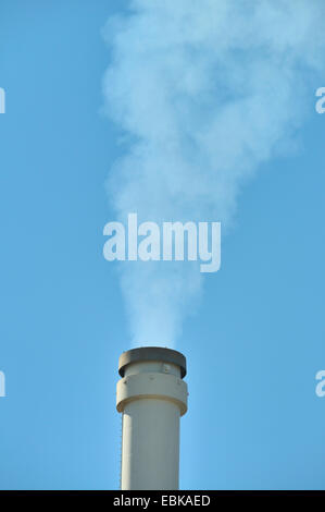 smoking chimney of a brown coal power station - Stock Photo