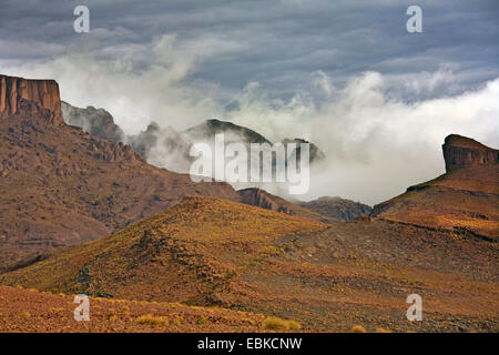rocky mountain landscape with fog, Morocco, Souss-Massa-DaraÔ, Djebel Sarhro - Stock Photo