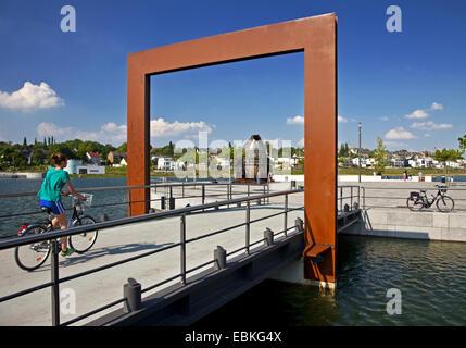 cyclist on footbridge with Thomas converter on Phoenix Lake, Germany, North Rhine-Westphalia, Ruhr Area, Dortmund - Stock Photo