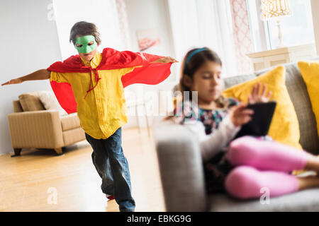 Children (6-7) playing at home - Stock Photo