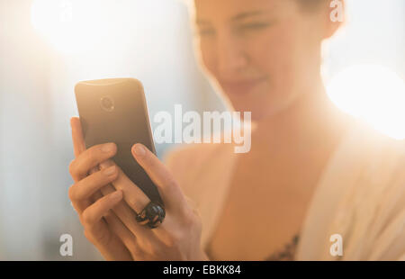 Young woman using mobile phone - Stock Photo