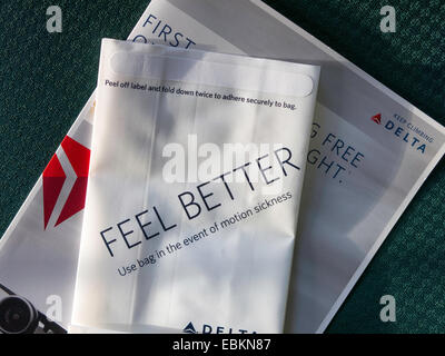 Delta Airlines Inflight Air Sickness Bag and Brochure on Airplane , USA - Stock Photo