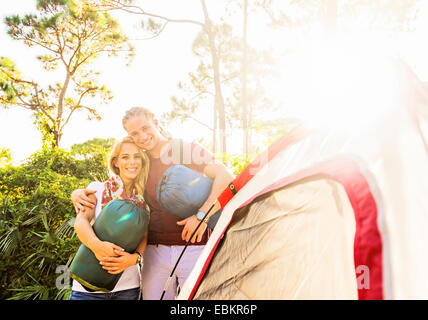 USA, Florida, Tequesta, Portrait of smiling couple standing together next to tent - Stock Photo