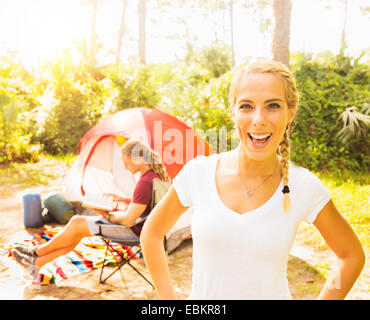 USA, Florida, Tequesta, Portrait of smiling woman and man reading book - Stock Photo