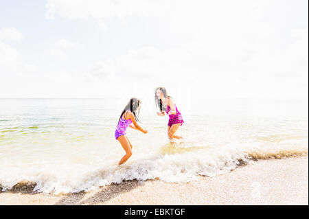USA, Florida, Jupiter, Girl (6-7) and her mom enjoying themselves on beach - Stock Photo