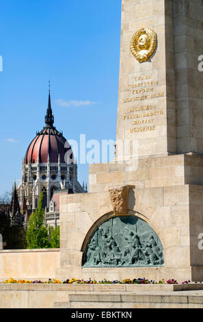 Budapest, Hungary. Soviet War Memorial in Szabadsag ter (square) Hungarian Parliament behind - Stock Photo
