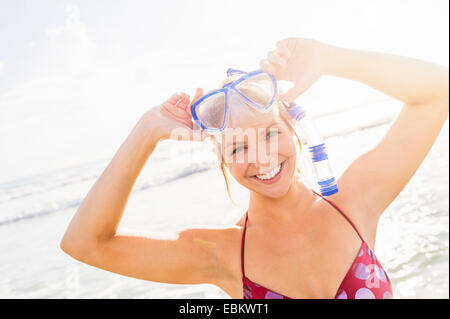 USA, Florida, Jupiter, Portrait of smiling young woman wearing scuba mask and snorkel - Stock Photo