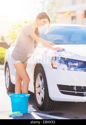 Portrait of smiling woman at car wash stock photo 73066440 alamy usa florida jupiter portrait of young woman washing white car stock photo solutioingenieria Choice Image
