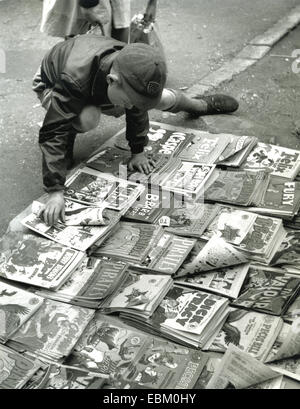 LONDON BOY WITH COMICS about 1955 - Stock Photo