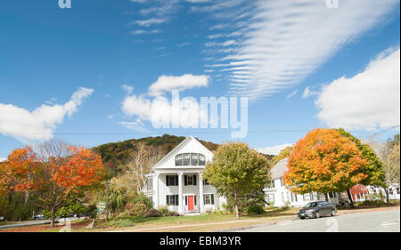 Newfane, Vermont, neighborhood scene, traditional white homes, vibrant fall trees and blue sky with interesting - Stock Photo