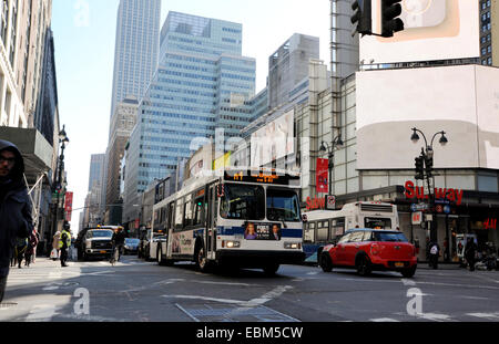 Manhattan New York USA November 2014  - Public transport bus driving through city centre - Stock Photo