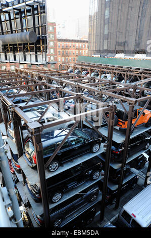 Manhattan New York USA November 2014  - Tight for space one of the innovative car park racks in the city centre - Stock Photo