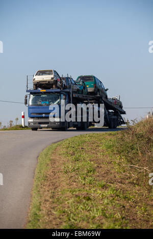 Car transporter carrying written off vehicles - Stock Photo
