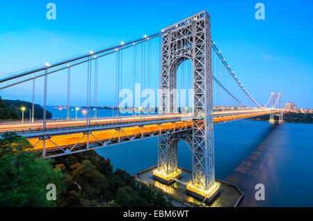 The George Washington Bridge spanning the Hudson River at twilight in New York City. - Stock Photo