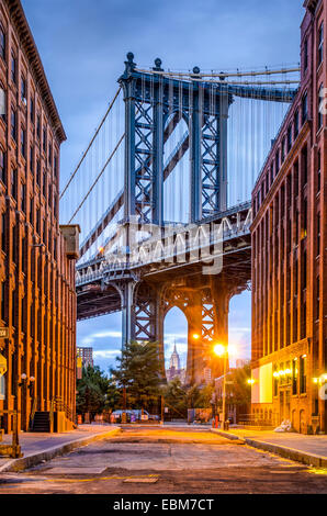 Cityscape of Manhattan Bridge from Brooklyn in New York City. - Stock Photo