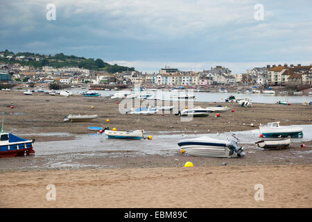 Boats stranded on the shore during a low tide - Stock Photo