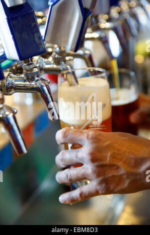 Bartender pouring a beer from the tap, Nexus Brewery & Restaurant, Albuquerque, New Mexico USA - Stock Photo
