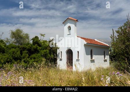 A chapel and wild flowers by Argostoli, Kefalonia - Stock Photo