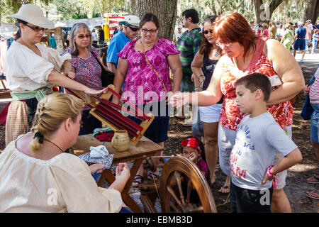 Lake Wales Florida Lake Wailes public park Pioneer Days festival annual event celebration demonstration woman spinning - Stock Photo