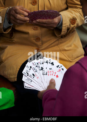 Hand holding playing cards - Stock Photo