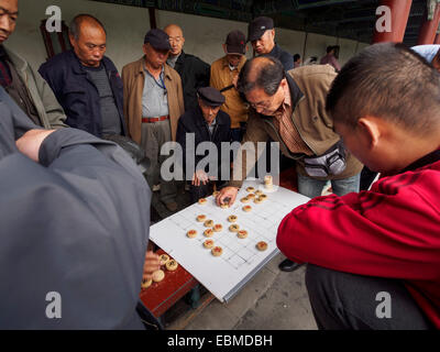 Old men playing a chinese chess board game Xiangqi - Stock Photo