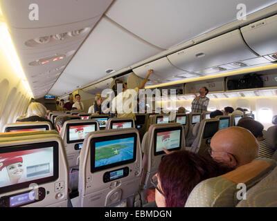 Emirates airline Boeing 777-300ER airplane cabin interior - Stock Photo