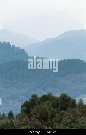 Aerial Perspective with haze turning the trees blue in Snowdonia, North Wales. - Stock Photo